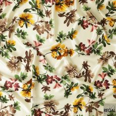 Cream silk satin fabric with olive green, yellow, black and brown print in floral design