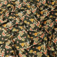 Dark uniform green synthetic satin fabric with multicolour print in floral design