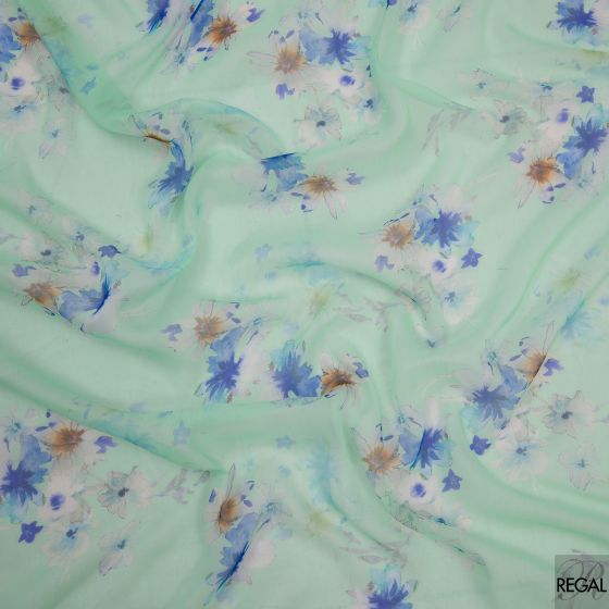 Light mint green chiffon fabric with blue and orange floral design