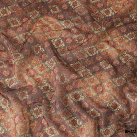 Black tussar silk fabric with orange, beige, olive green and red print in geometric design