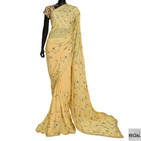 Mustard yellow crepe georgette saree in leaf design with bead work, sequins and stones.
