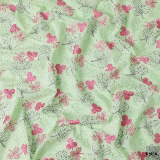 Mint green cotton voile fabric with pink, grey and green embroidery in floral design